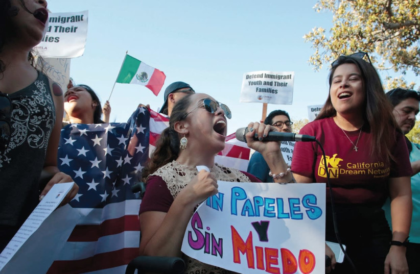 PAULINA RUIZ chants with supporters of the Deferred Action for Childhood Arrivals program on Olivera Street in Los Angeles, California, earlier this week. (photo credit: KYLE GRI/REUTERS)