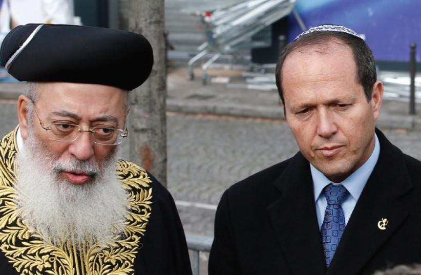Shlomo Amar, at the time Sephardi chief rabbi of Israel, attends a memorial ceremony at the Hyper Casher kosher supemarket in Paris together with Jerusalem Mayor Nir Barkat in January 2015. (photo credit: REUTERS)