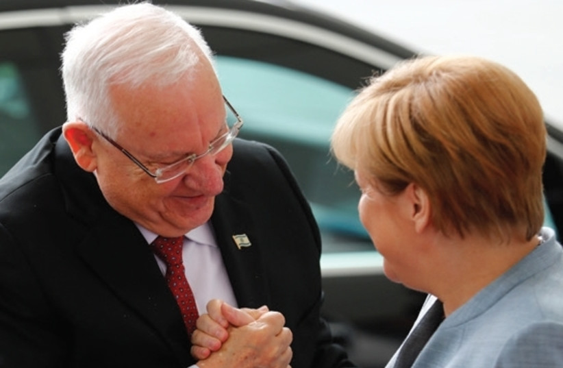 PRESIDENT REUVEN RIVLIN is greeted by German Chancellor Angela Merkel at the Chancellery in Berlin. (photo credit: REUTERS)