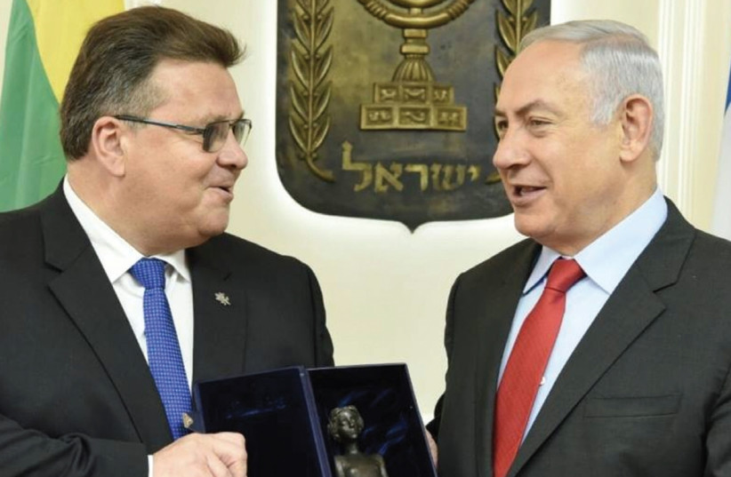 LITHUANIAN FOREIGN MINISTER Linas Linkevicius presents Prime Minister Benjamin Netanyahu with a replica of a little girl from a Holocaust memorial in Lithuania during their meeting in Jerusalem on Monday. (photo credit: LITHUANIAN EMBASSY ISRAEL)