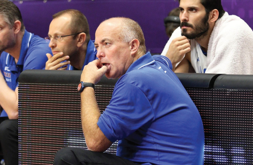 Coach Erez Edelstein (center) and captain Omri Casspi (right) will not be involved in Israel's World Cup 2019 qualifying campaign which gets under way in November, with the former to be told he will not continue after the dejecting EuroBasket campaign and the latter set to be busy playing with the G (photo credit: ADI AVISHAI)