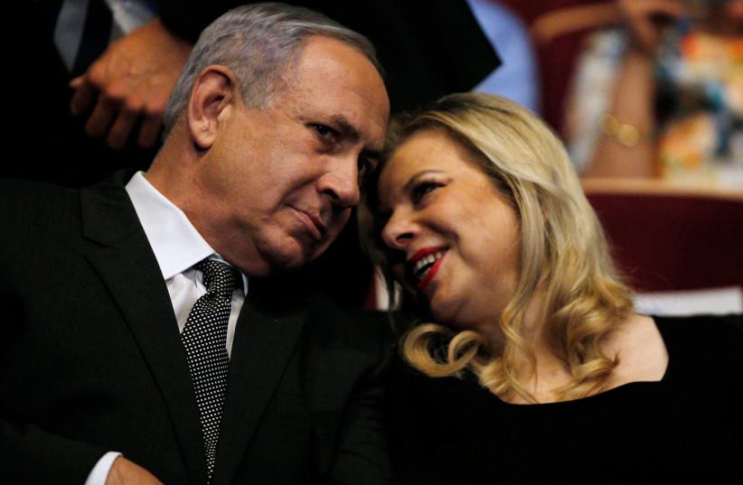 Israeli Prime Minister Benjamin Netanyahu (L) and his wife Sara (photo credit: REUTERS)