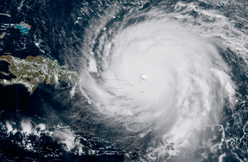 Hurricane Irma, a record Category 5 storm, is seen approaching Puerto Rico in this NASA's GOES-16 satellite image taken at about 15:15 EDT on September 6, 2017. (photo credit: COURTESY NOAA NATIONAL WEATHER SERVICE NATIONAL HURRICANE CENTER/HANDOUT VIA REUTERS)