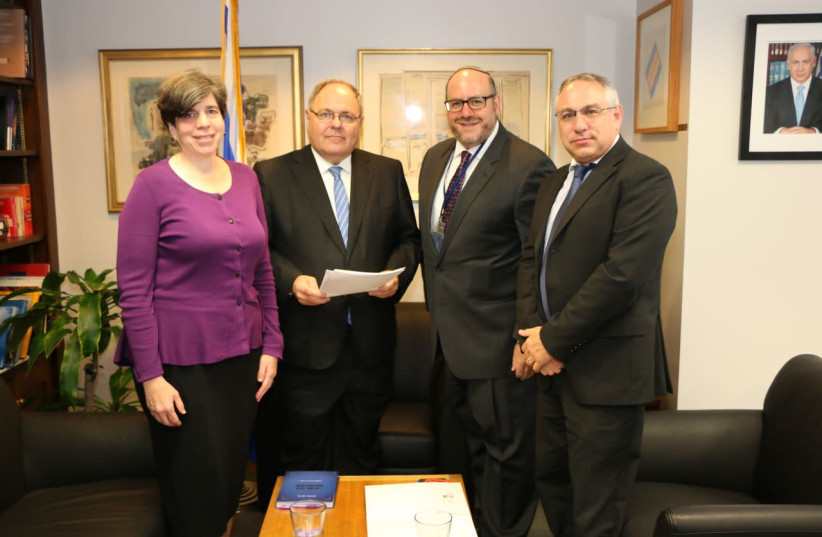 Rabbi Steven Wernick, CEO of USCJ (The United Synagogue of Conservative Judaism) and Rabbi Julie Schonfeld, CEO of the Rabbinical Assembly hand delivered an open letter addressed to Prime Minister Benjamin Netanyahu to  Dani Dayan, Consul General of Israel in New York, September 7, 2017. (photo credit: Courtesy)