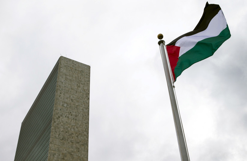 The Palestinian flag flies after being raised by Palestinian President Mahmoud Abbas in a ceremony at the United Nations General Assembly. (photo credit: REUTERS)