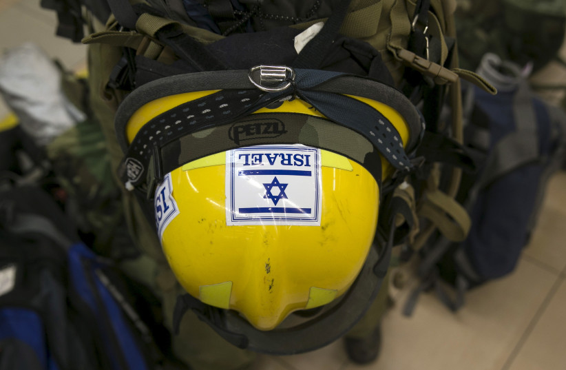 The helmet of an Israeli soldier and member of an aid delegation is seen as he waits for a flight to Nepal at Ben Gurion international airport near Tel Aviv, Israel April 26, 2015. (photo credit: REUTERS)