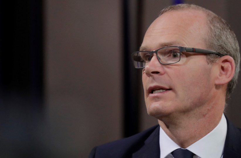 Irish Foreign Minister Simon Coveney at a meeting of EU foreign ministers in Estonia, September 2017  (photo credit: REUTERS/INTS KALNINS)