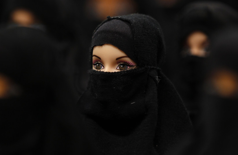 A German art installation showing 100 Barbie dolls with burkas, 2012 (photo credit: REUTERS/INA FASSBENDER)