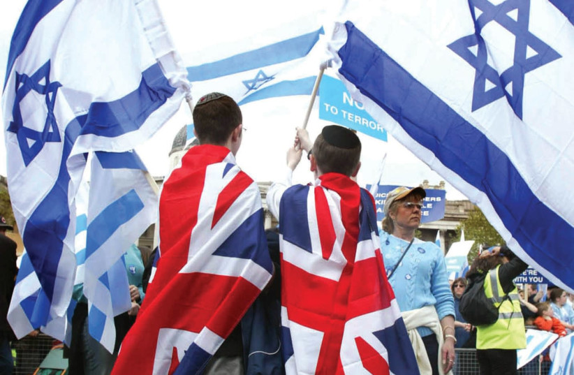 UK AND Israeli flags together at a march in London. (photo credit: REUTERS)