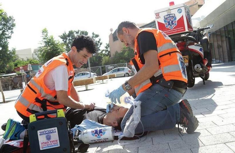United Hatzalah paramedics practice CPR on a volunteer. (photo credit: COURTESY UNITED HATZALAH)