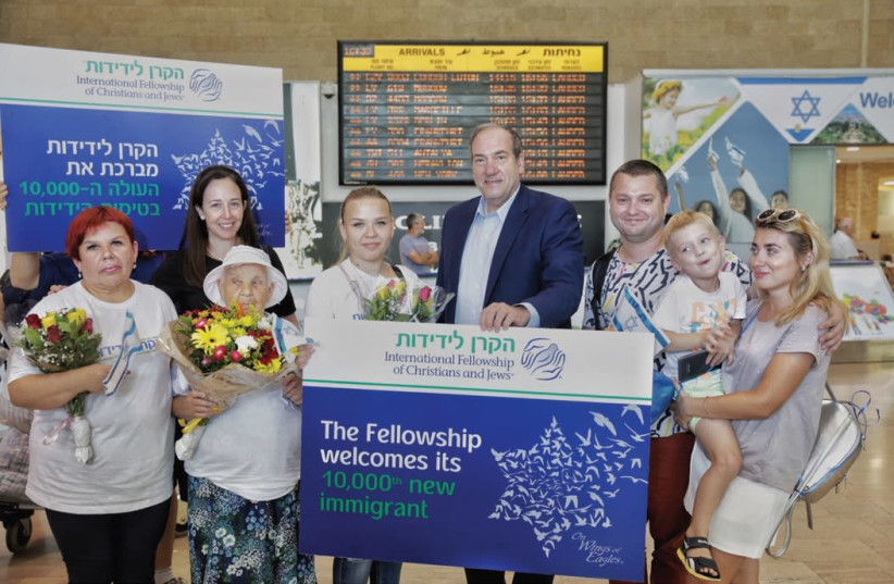 IFCJ Founder Yechiel Eckstein poses with the Pokutnia family at Ben-Gurion Airport last week. (photo credit: OLIVIA FITUSSI)