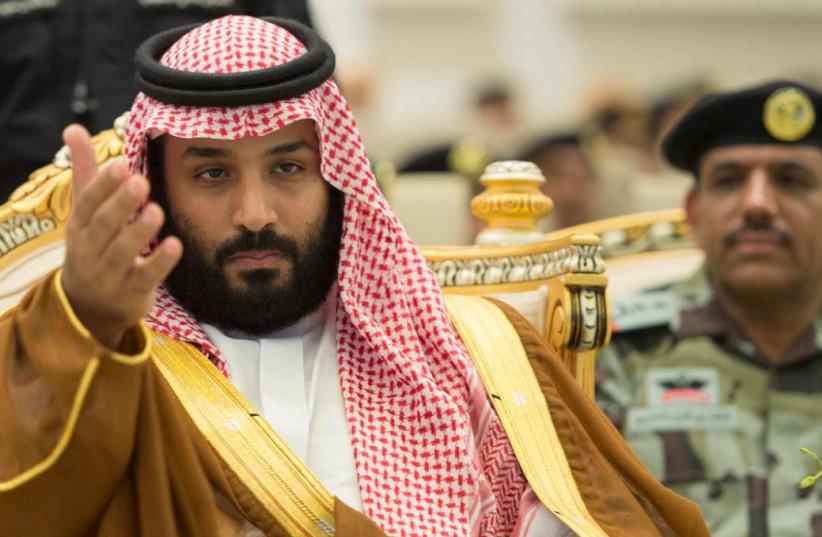 Saudi Crown Prince Mohammed bin Salman gestures during a military parade (photo credit: SAUDI PRESS AGENCY/REUTERS)