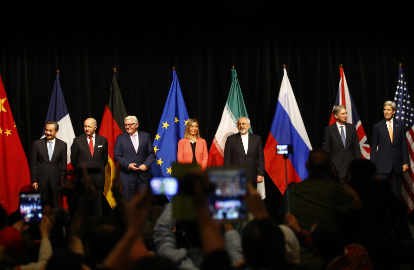 Representatives pose after Iran and six major world powers reached a nuclear deal, capping more than a decade of on-off negotiations, July 14, 2015 (photo credit: REUTERS)
