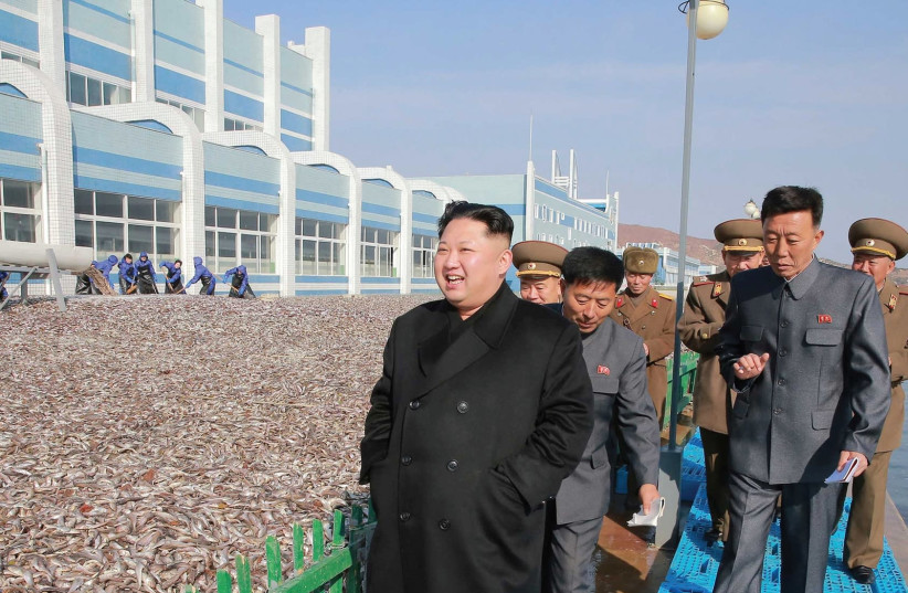 NORTH KOREAN leader Kim Jung-un visits fishery stations, which made an unprecedented catch of fish in 2016. (photo credit: REUTERS)