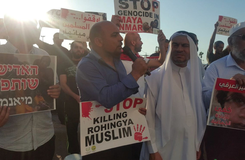 MK MASOUD GNAIM (center) participates in a protest against the killing of his Rohingya Muslim 'brothers' in Myanmar, outside the country's embassy in Tel Aviv, September 11, 2017. (photo credit: UNITED ARAB LIST)