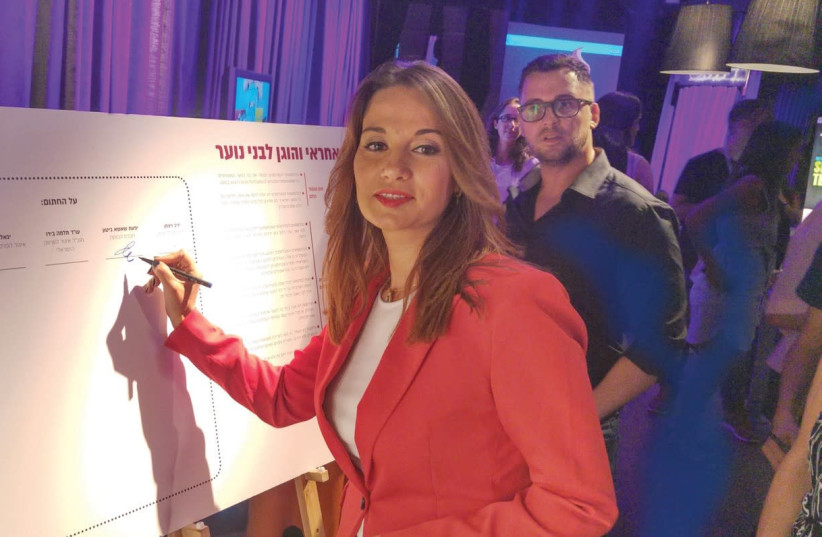 MK YIFAT SHASHA-BITON, chairwoman of the Knesset's Special Committee for the Rights of the Child, signs an agreement for responsibility in advertising yesterday at the annual Marketing Conference for Children and Young Adults in Tel Aviv. (photo credit: Courtesy)