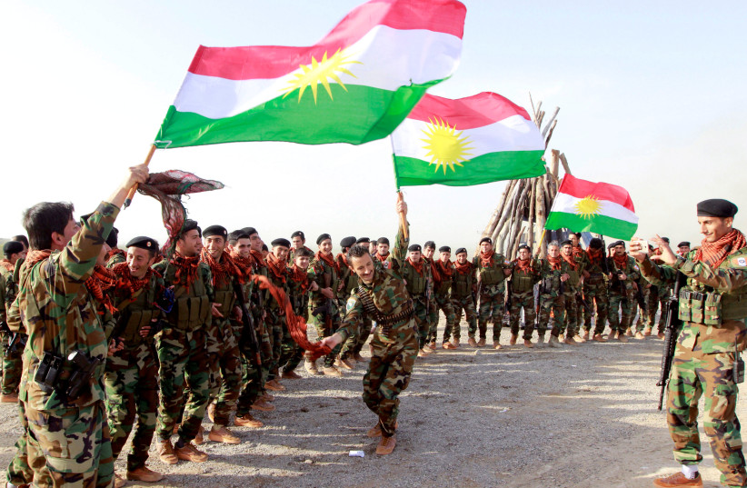 Kurdish Peshmerga forces celebrate Newroz Day, a festival marking spring and the new year, in Kirkuk March 20, 2017 (photo credit: AKO RASHEED / REUTERS)