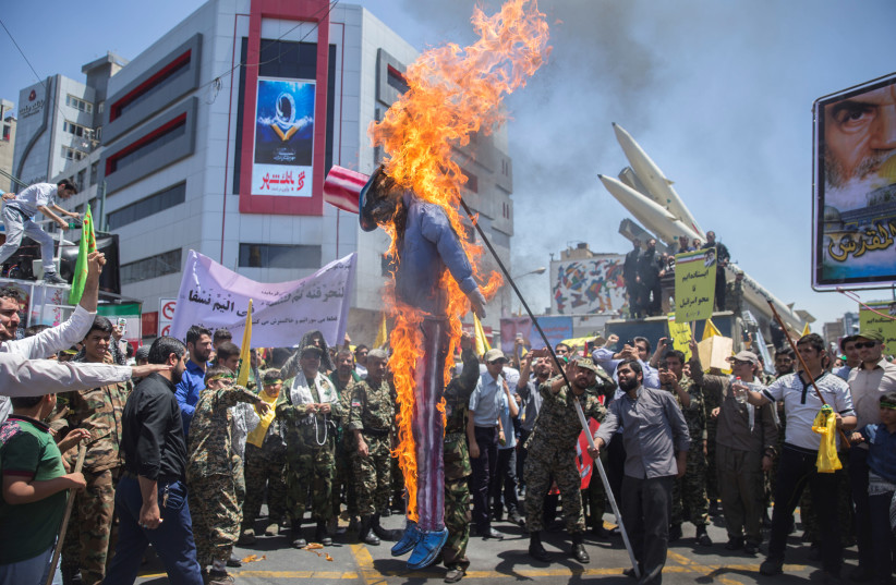 A scarecrow model is set on fire by Iranian demonstratorson during the annual pro-Palestinian rally marking Al-Quds Day in Tehran, Iran, June 23, 2017. (photo credit: NAZANIN TABATABAEE YAZDI/ TIMA VIA REUTERS)