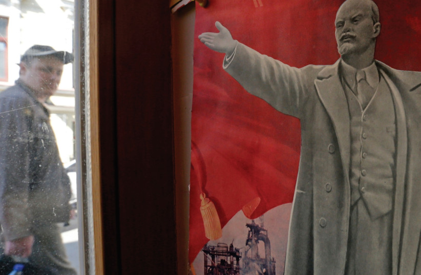 A HISTORIC poster of Vladimir Lenin on display in St. Petersburg (photo credit: REUTERS)