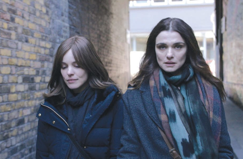 Rachel McAdams (left) and Rachel Weisz are star-crossed lovers in 'Disobedience.' (photo credit: Courtesy)