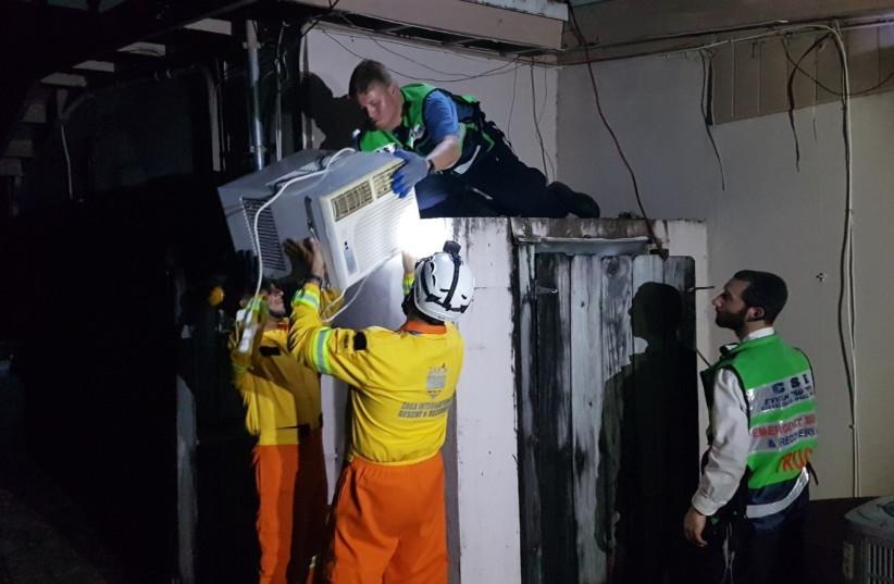 Israeli ZAKA volunteers help Floridians in the wake of Hurricane Irma.  (photo credit: ZAKA)