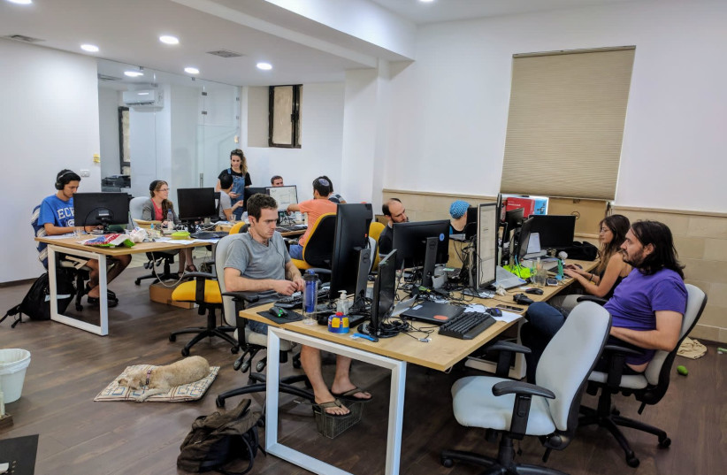 EMPLOYEES AT the 200 Apps smartphone and web application developer work in their new office in Jerusalem's German Colony neighborhood (photo credit: Courtesy)