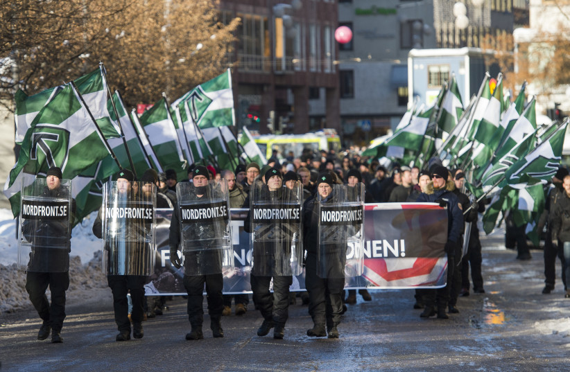 The neo-nazi Nordic Resistance Movement (Nordiska motstandsrorelsens) sympathisers demonstrate in central Stockholm (photo credit: JONATHAN NACKSTRAND/AFP)