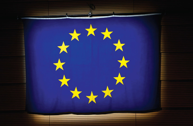 A European Union (EU) flag is pictured during a ceremony in Lausanne. (photo credit: REUTERS)