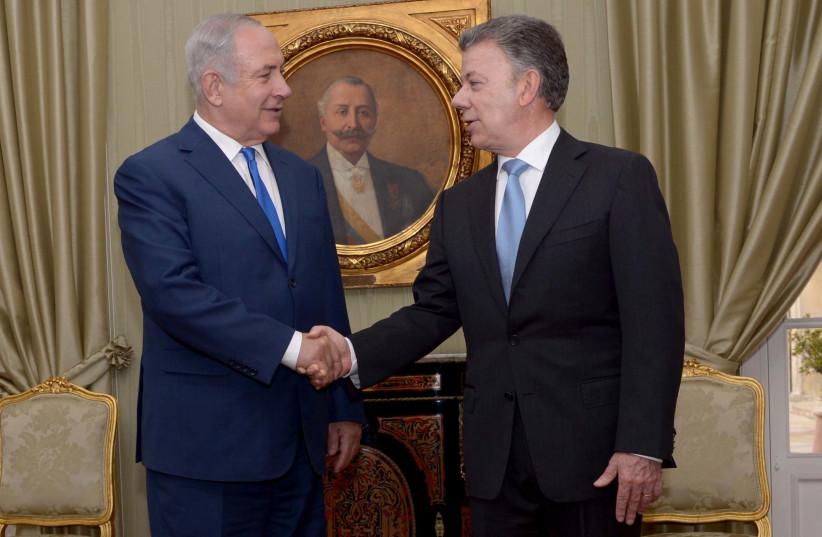 Israeli Prime Minister Benjamin Netanyahu meets with Colombia's President Juan Manuel Santos (photo credit: AVI OHAYON - GPO)