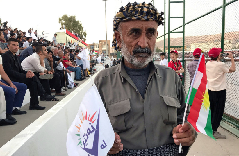 """A supporter of the """"NO For Now"""" movement attends a rally calling on Iraqi Kurds to vote against the referendum, in Sulaimaniyah, Iraq (photo credit: REUTERS/RAYA JALABI)"""