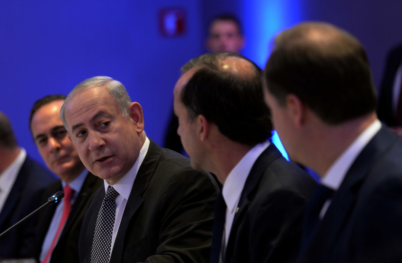 Prime Minister Netanyahu is speaking with the top businessmen of Mexico. (photo credit: AVI OHAYON - GPO)