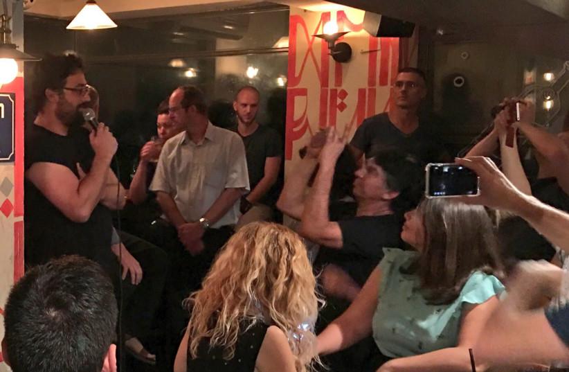 Lior Meiri (far left) speaking at a Tel Aviv bar at a New Likudniks event in September 2017. (photo credit: Lahav Harkov)