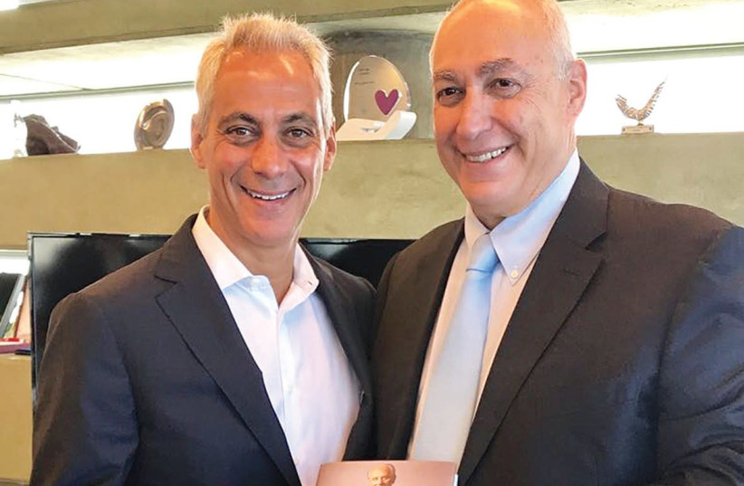 Chemi Peres and Chicago Mayor Rahm Emmanuel display a copy of Shimon Peres' autobiography  (photo credit: Courtesy)