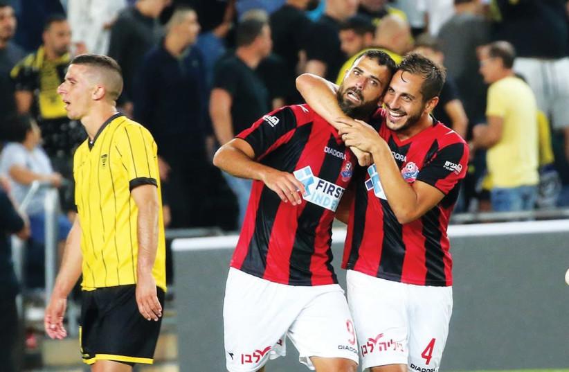 Hapoel Haifa striker Eden Ben-Basat (center) celebrates with teammate Dor Malul. (photo credit: UDI ZITIAT)