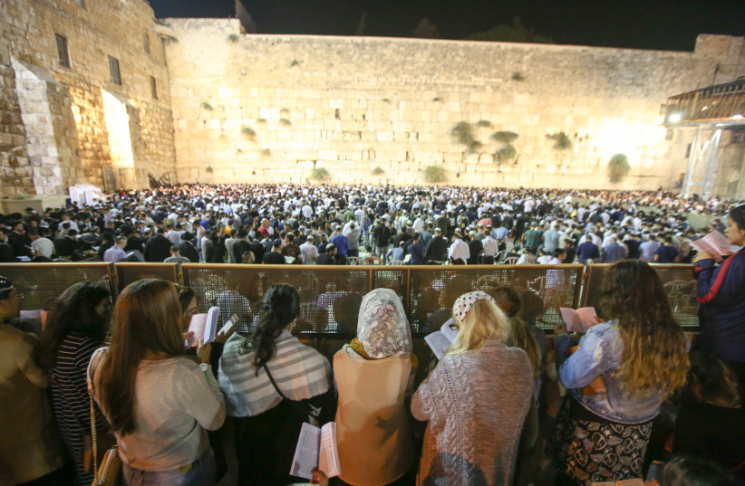 Women reading selichot -- Jewish penitential poems and prayers said leading up to the High Holidays -- at the Western Wall before Rosh Hashana (photo credit: MARC ISRAEL SELLEM)