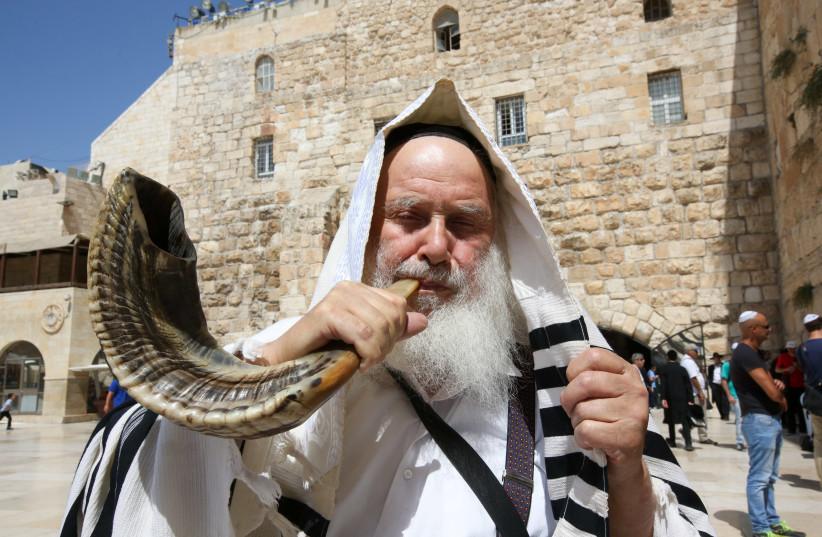 Blowing the shofar at the Western Wall before Rosh Hashana (photo credit: MARC ISRAEL SELLEM)
