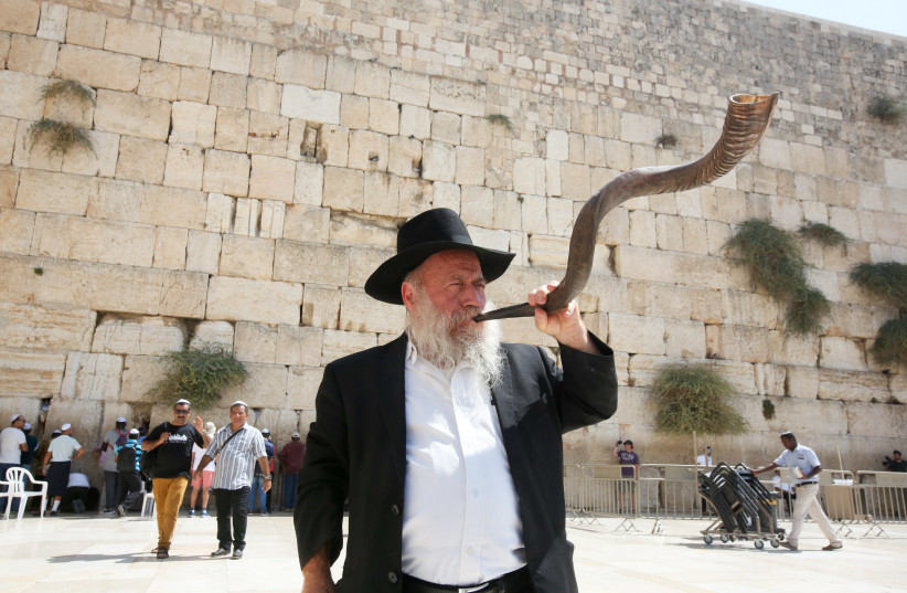 Man blowing the shofar at the Western Wall before Rosh Hashana (photo credit: MARC ISRAEL SELLEM)