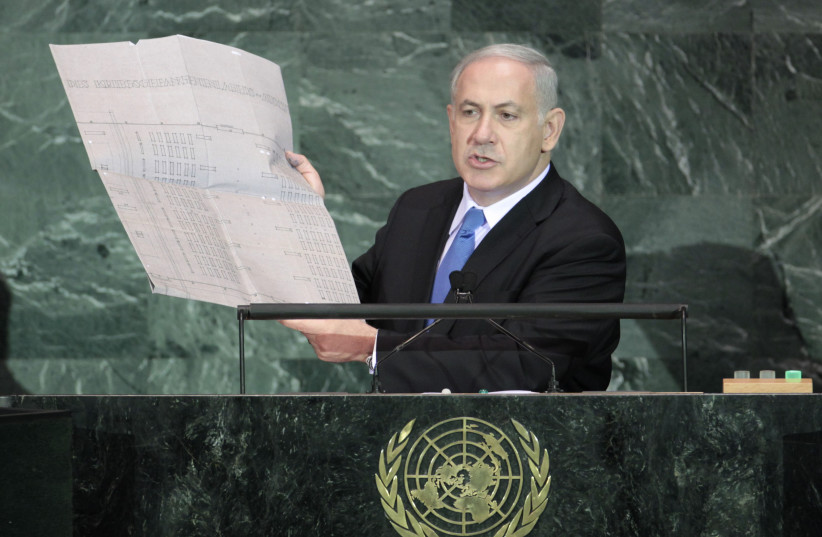 Israeli Prime Minister Benjamin Netanyahu holds up a document outlining plans for the Auschwitz death camp as he addresses the 64th United Nations General Assembly at U.N. headquarters in New York, September 24, 2009.  (photo credit: REUTERS/LUCAS JACKSON)