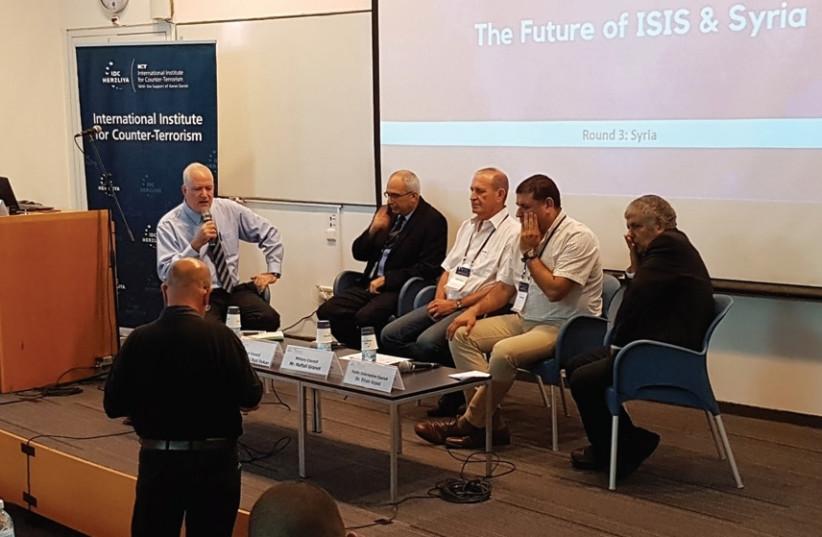 FROM LEFT: Boaz Ganor, Uri Ben Yaakov, Naftali Granot, Eyal Dykan and Eitan Azani address the IDC Herzliya International Institute for Counter-Terrorism conference on Thursday (photo credit: YONAH JEREMY BOB)