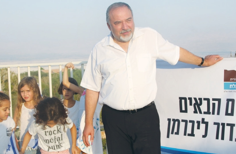 DEFENSE MINISTER Avigdor Liberman participates in a Rosh Hashana toast yesterday in the West Bank settlement of Vered Yeriho. (photo credit: TOVAH LAZAROFF)