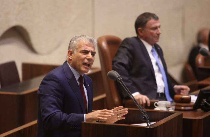 Yesh Atid leader Yair Lapid at the Knesset plenum discussing goverment allowances for the handicap, September 18, 2017. (photo credit: MARC ISRAEL SELLEM/THE JERUSALEM POST)
