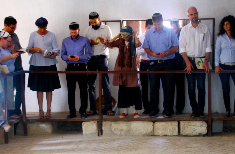 MKs pray at the Shalom Al Yisrael synagogue in Jericho.  (photo credit: TOVAH LAZAROFF)