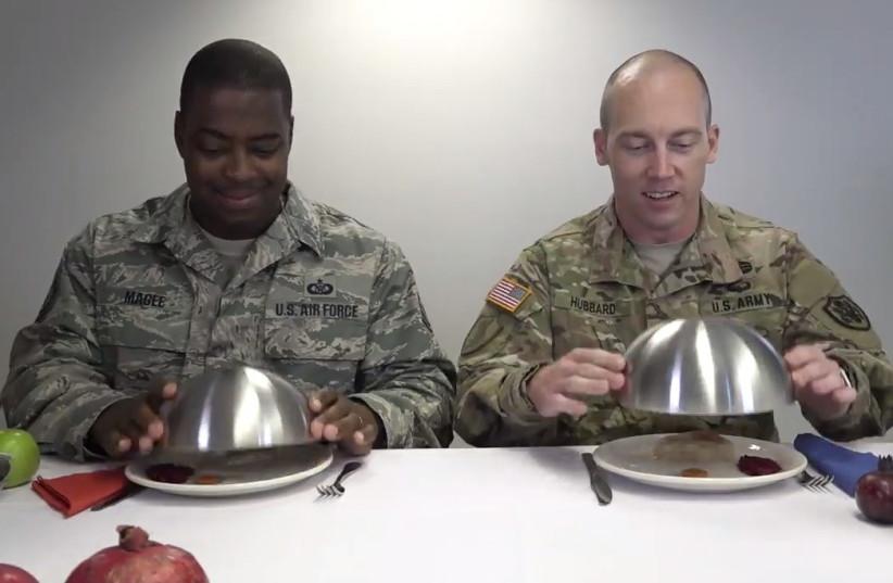 US diplomats try traditional Rosh Hashana dishes.  (photo credit: screenshot)