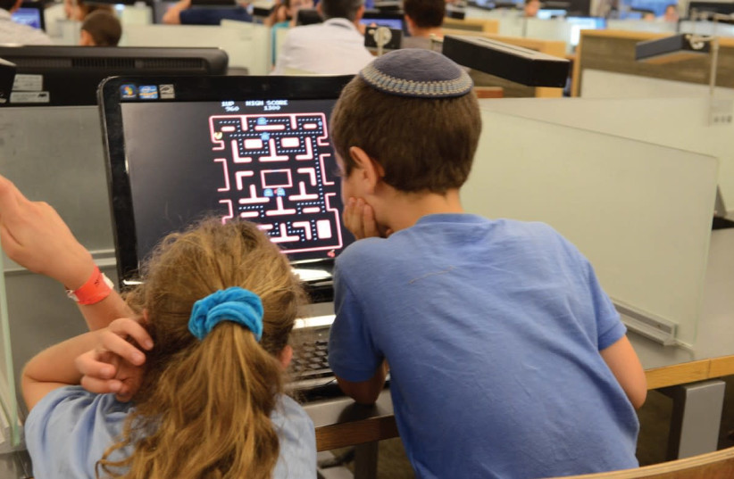 CHILDREN PARTICIPATE in technology-related activities during Scientists' Night at the University of Haifa in 2016 (photo credit: Courtesy)