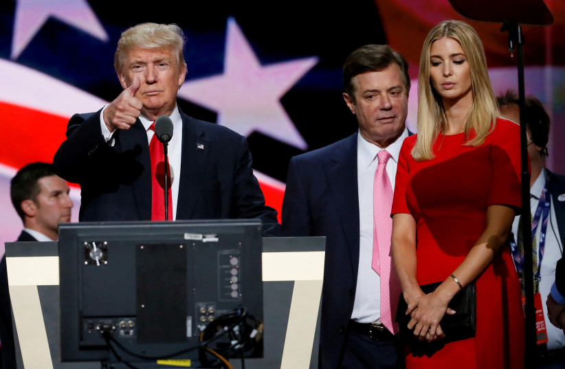 Then-Republican presidential nominee Donald Trump gives a thumbs up as his campaign manager Paul Manafort (C) and daughter Ivanka (R) look on during Trump's walk through at the Republican National Convention in Cleveland, US, July 21, 2016 (photo credit: RICK WILKING / REUTERS)