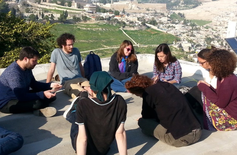 Achvat Amim participants on the roof of the Willy Brandt Center in Jerusalem, January 2016. (photo credit: A. DANIEL ROTH)