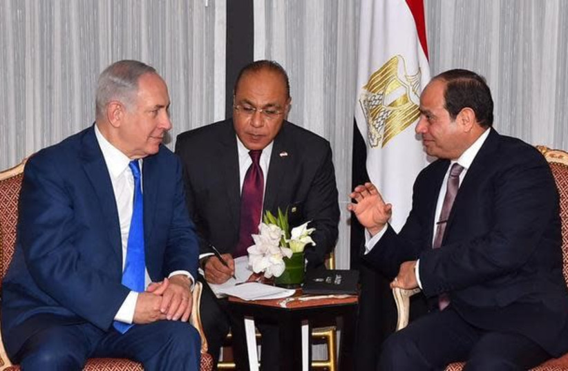 Egyptian President Abdel Fattah al-Sisi (R) speaks with Israeli Prime Minister Benjamin Netanyahu (L) during their meeting as part of an effort to revive the Middle East peace process ahead of the United Nations General Assembly in New York, U.S., September 19, 2017 in this handout picture courtesy  (photo credit: REUTERS)