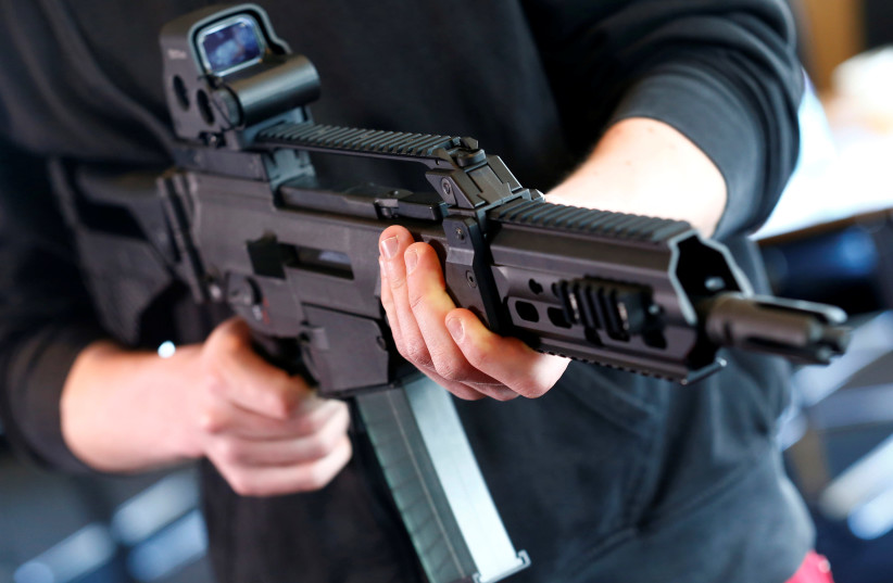 A man holds a G 36 KA rifle manufactured by Heckler & Koch (photo credit: REUTERS/RALPH ORLOWSKI)