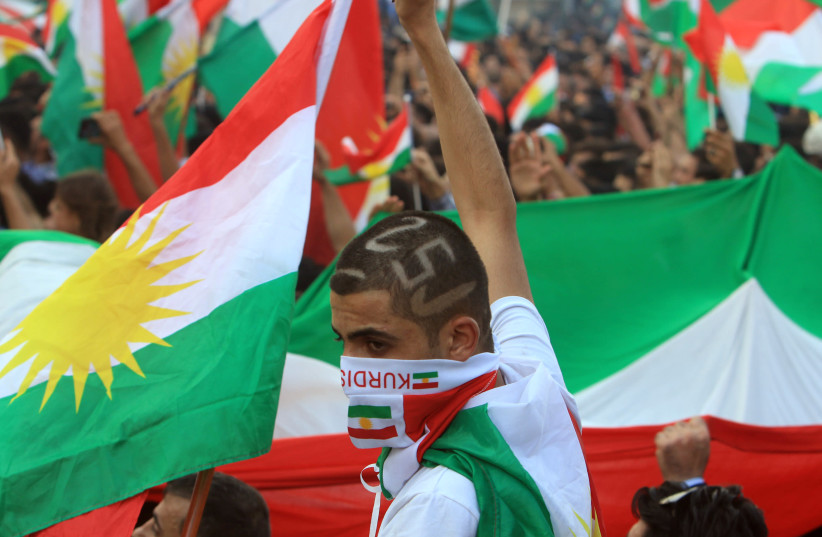 Kurds attend a rally to show their support for the upcoming September 25th independence referendum in Duhuk, Iraq  (photo credit: ARI JALAL / REUTERS)