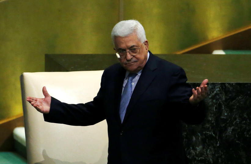 Palestinian President Mahmoud Abbas greets delegates after addressing the 72nd United Nations General Assembly at U.N. headquarters in New York, US, September 20, 2017.  (photo credit: EDUARDO MUNOZ / REUTERS)